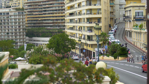 Urban road traffic and modern residential buildings in Monte Carlo, Monaco life Footage