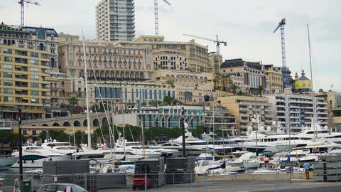 Apartment buildings and yachts docked in harbor, daytime view of Monte Carlo Footage