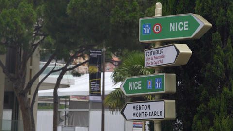 Road sign in Monaco indicating direction to Nice and Menton, road trip to Europe Footage