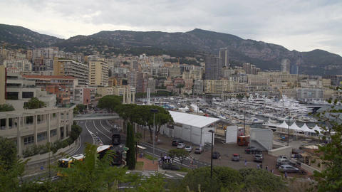 Everyday life in Monaco, people walking and public transport driving streets Footage