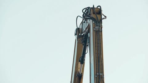 Hydraulic control system of excavator boom in operation on construction site Footage