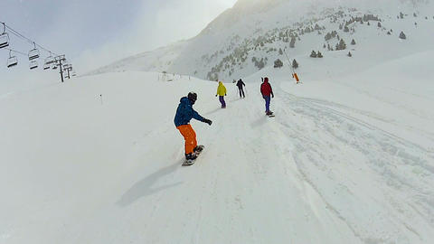 Energetic people go snowboarding and skiing in mountains, enjoying active life Footage