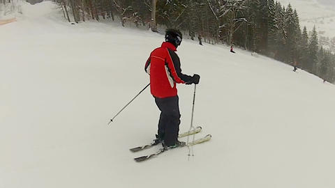 Man enjoying ski ride at mountain resort, active lifestyle, winter recreation Live Action