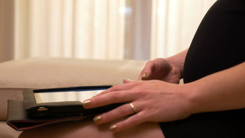 Closeup of future mom browsing tablet PC app and touching pregnant tummy Footage