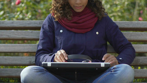 Attractive biracial woman shutting laptop after listening to music, relaxation Footage