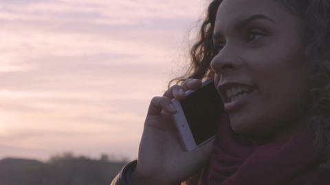 Delighted multiracial woman talking on smartphone with parents, communication Footage