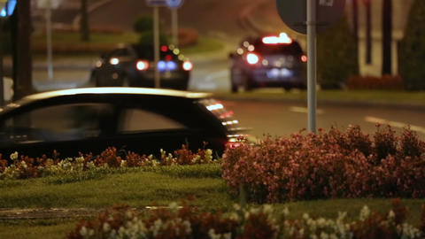Cars driving night urban street, designated driver or taxi services, comfort Footage