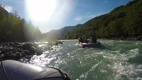Inexperienced rafting team stuck in shallow section of river, waiting for help Footage