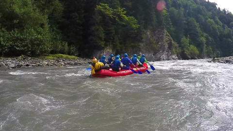 Competitive team rafting on boats through fast river torrent, extreme sports Live Action