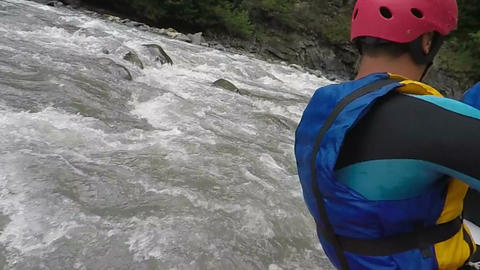 Brave male athletes paddling in rafting boats, extreme and dangerous sports Footage