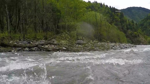 Rafting with large waves, rocks and hazards requiring precise maneuvering Footage