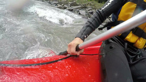 Rafter hardly overcoming steep rapids and underwater rocks of troubled river Footage