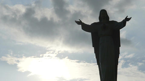 Jesus Christ statue against cloudy sky background, Son of God blessing, religion Footage