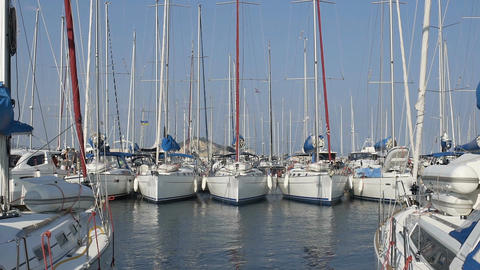 Boats docked at sailing sport club, racing yachts floating on water at marine Footage