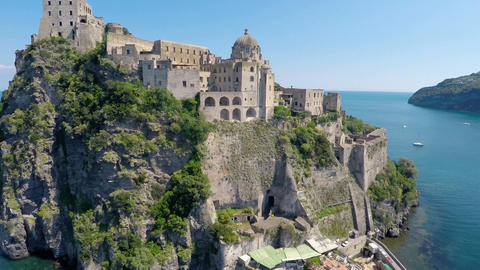 Beautiful Aragonese Castle near Ischia island surrounded by turquois gulf water Footage