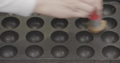 Scattering oil on the Takoyaki iron plate Footage