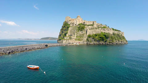 Beautiful medieval Aragonese Castle on volcanic island, turquois Gulf of Naples Footage