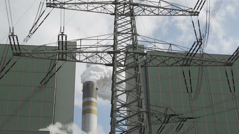 Industrial Smoke Stack and Electrical Pylon Closeup Footage