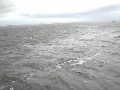 Sea of Troubles with the ship's deck. Waves in cloudy weather Live Action