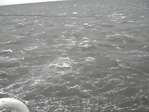 Sea of Troubles with the ship's deck. Waves in cloudy weather Footage