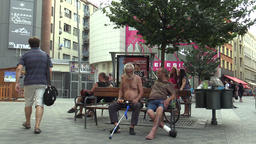 Authentic emotion homeless men on a bench, one homeless go to trash Footage