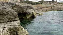 Spain Mallorca Island Cala Blava 006 rocky shoreline with grotto Footage