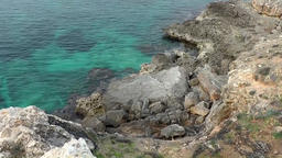 Spain Mallorca Island Cala Blava 010 mottled turquoise water and rocky shore Footage
