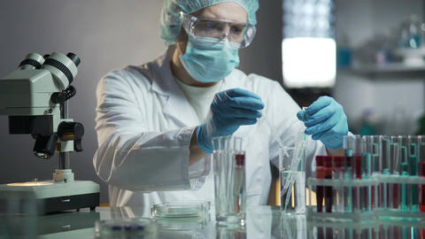 Laboratory worker calculating exact formula of hypoallergenic cosmetic products Footage