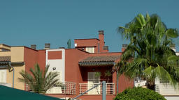 Spain Mallorca Island Cala Blava 025 colorful spanish row house and palm trees Footage