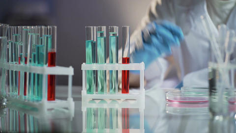 Laboratory worker taking away already tested flask with substance, work process Footage