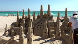 Spain Mallorca Island Playa de Palma 002 giant sandcastle on white sandy beach Footage