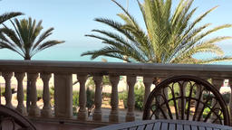 Spain Mallorca Island Playa de Palma 009 palms and sea behind balcony railing Footage