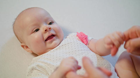 Cute Baby is playing with Mother's Hands Smiling Surprising Footage