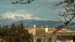 Spain Mallorca Island various 004 snow covered mountains behind country house Footage