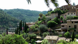 Spain Mallorca Island various 050 houses and gardens of village Deia at hillside Footage