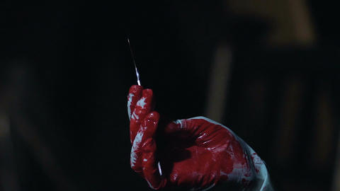 Bloody scalpel in hands of cruel maniac, person enjoying committed murder Live Action