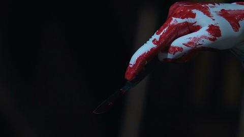 Crazy maniac killer cutting victim with bloody scalpel, human organ trafficking Live Action