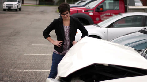 Young millennial hipster woman mourns her car accident in parking lot Footage