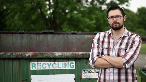 Handsome young garbage owner entrepreneur serious about recycling and saving the Footage