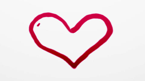 Heart symbol painted by red paint on white Stock Video Footage