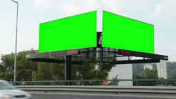 two billboards in the city near road - green screen - buildings in background -  Footage