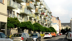 city - urban street with parked cars - flats (apartments) - sunlight Footage