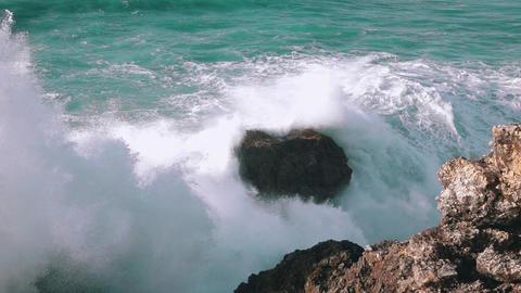 Slow Motion Ocean Waves Breaking on Rocks Footage