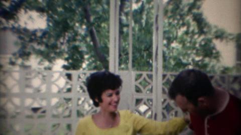 1969: Women flirts with tall drunk funny meathead man Footage