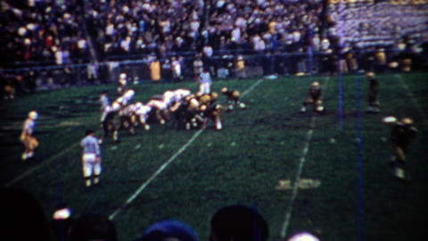 1969: Purdue college football team kicks a field goal scoreboard shows big lead Footage