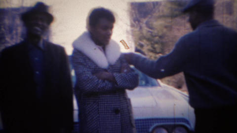 1969: Family leaves in white early 60's Lincoln giant car Footage