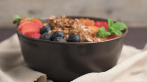 Yogurt with baked granola and berries Footage