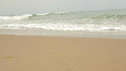 Beach on a cloudy day. Medium shot