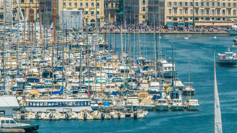 Yachts and boats moored in Old Port of Marseille, timelapse of moving vessels Footage