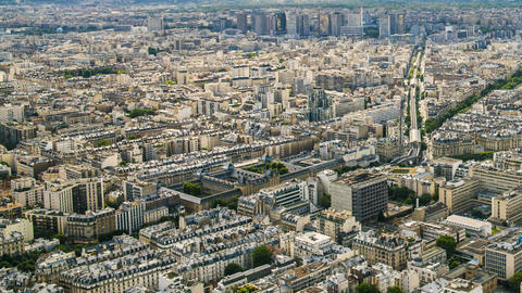 Top view of Paris, shadows of clouds moving above buildings, city life timelapse Footage